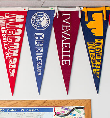 College pendant banners hanging on the wall in the college and career center.
